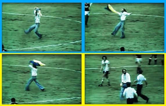 Д. Мигаль з українським прапором на полі під час гри збірних НДР і СРСР. Монреаль, 1976